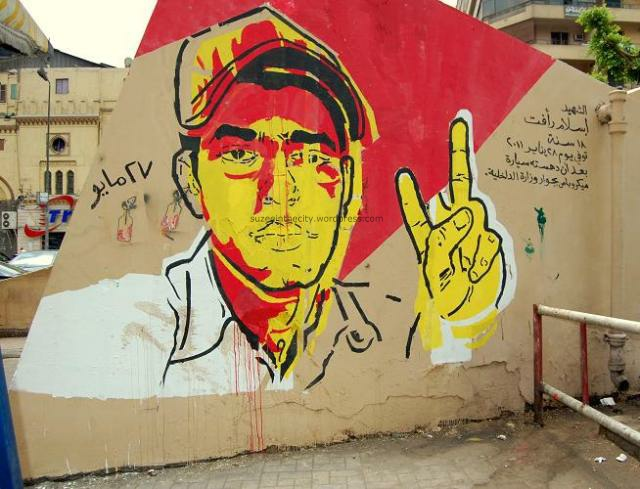 Martyr Mural by Ganzeer of Islam Raafat, 18 yrs old, run over by microbus during protest on Jan 28.