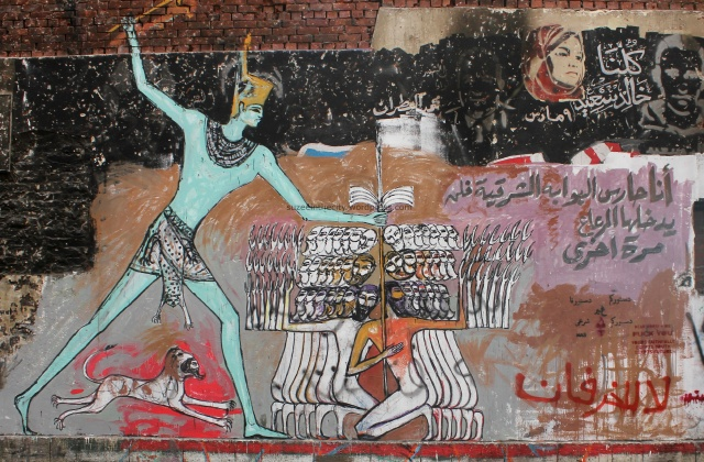 Alaa Awad returns with a pharaonic mural that reads 'I am the guardian of the Eastern gates; the [Mer3a] shall not return again